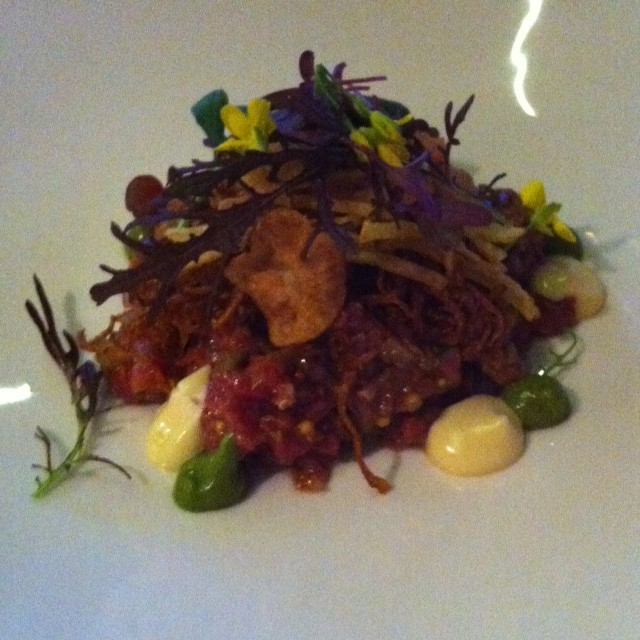 Steak Tartare  Premium raw diced eye fillet, organic egg yolk, crispy onion,  French fries, herb emulsion, cos lettuce